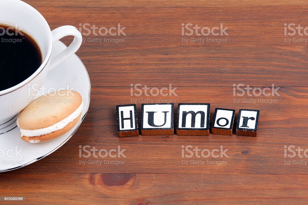 Coffee cup on a wooden table and text - Humor