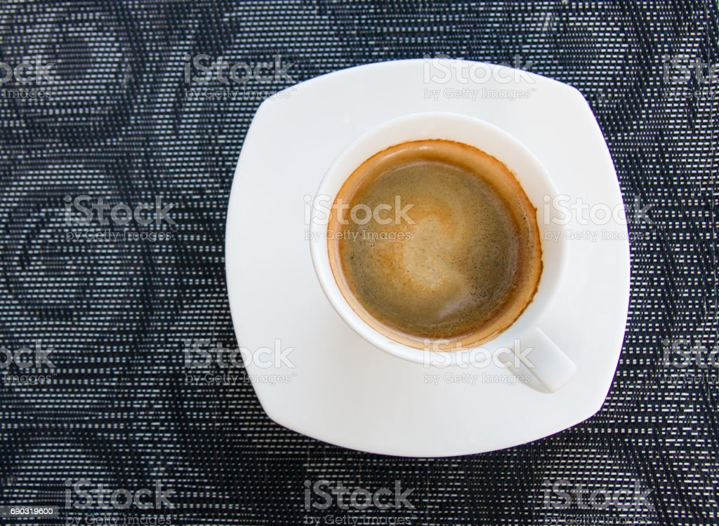 Coffee cup on beautiful  plate mat stock photo