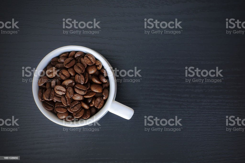 coffee cup on black wood table royalty-free stock photo