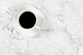 istock coffee cup on marble table background 1006733290