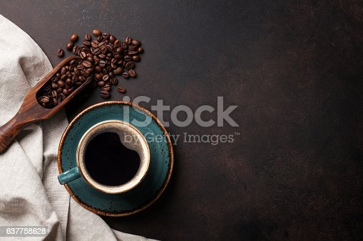 istock Coffee cup on old kitchen table 637758628