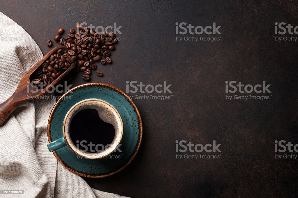 Coffee cup on old kitchen table stock photo
