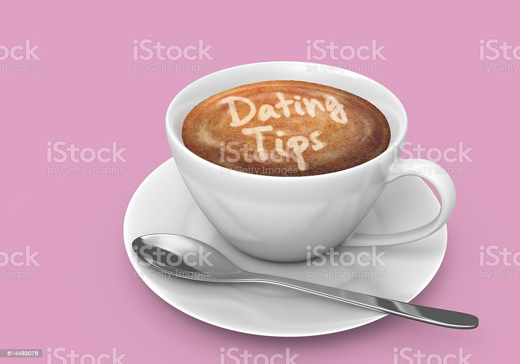 Coffee cup on saucer with dating tips written in foam stock photo