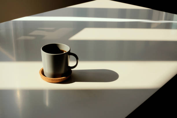Coffee cup on table photo taken in natural sunlight Coffee cup on table photo taken in natural sunlight black coffee stock pictures, royalty-free photos & images