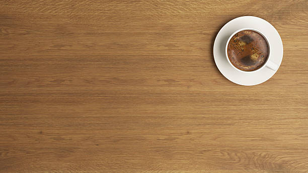 coffee cup on the wooden desk concept - paysage urbain photos et images de collection