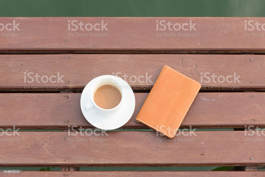 Coffee cup on wood stock photo