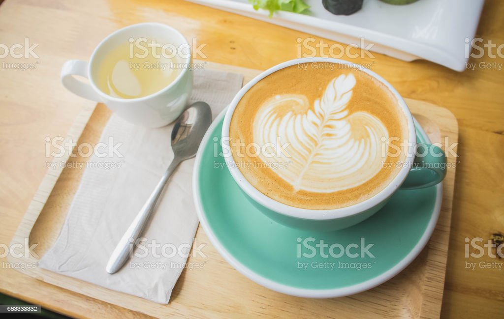 coffee cup on wood table in coffee shop royalty-free stock photo