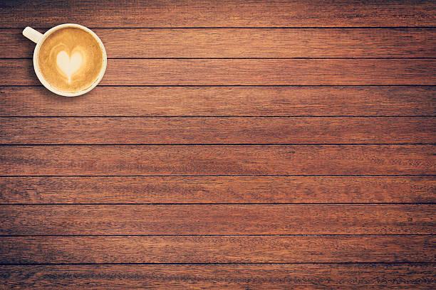 coffee cup on wood texture and background with space. - wärmeplatte stock-fotos und bilder