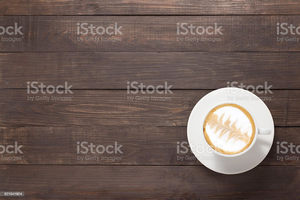 Coffee cup on wooden background. Top view stock photo