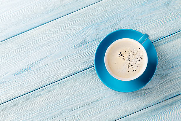 Coffee cup on wooden table background stock photo
