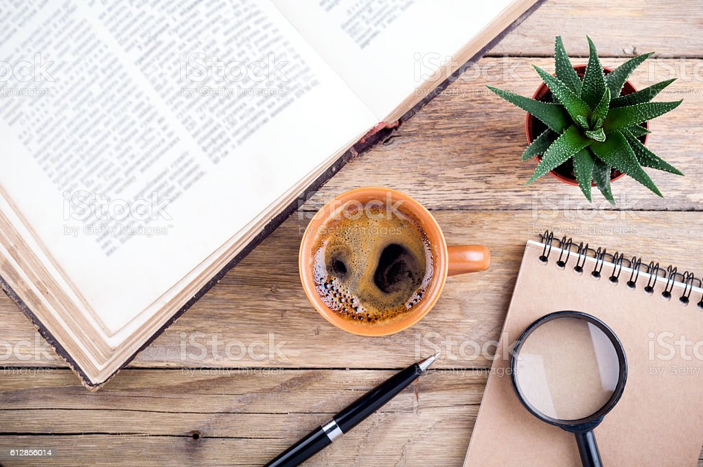 Coffee cup, open book, notebook and succulent aloe. Educations concept stock photo