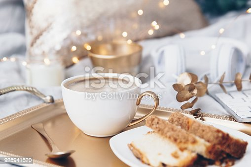 istock Coffee cup over cold tray. Trendy instagram image in gold tones 925941520