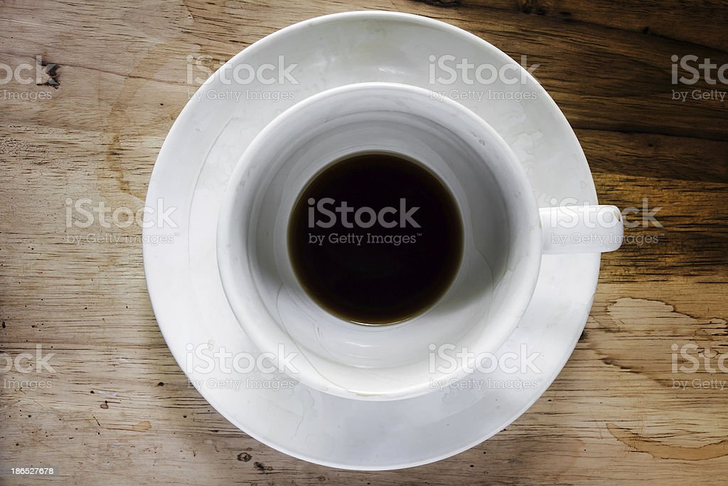 Coffee cup over wood table royalty-free stock photo