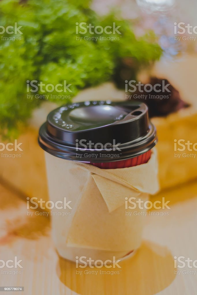 Coffee cup paper on the table stock photo