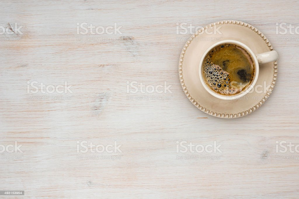 Coffee cup top view on wooden table texture background stock photo