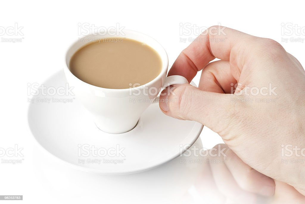 Coffee cup with a hand royalty-free stock photo