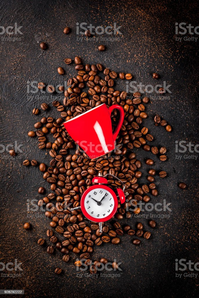 Coffee cup with alarm clock stock photo
