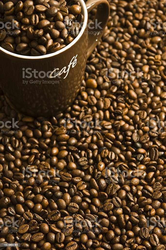 Coffee Cup With Beans Inside and as a Background royalty-free stock photo