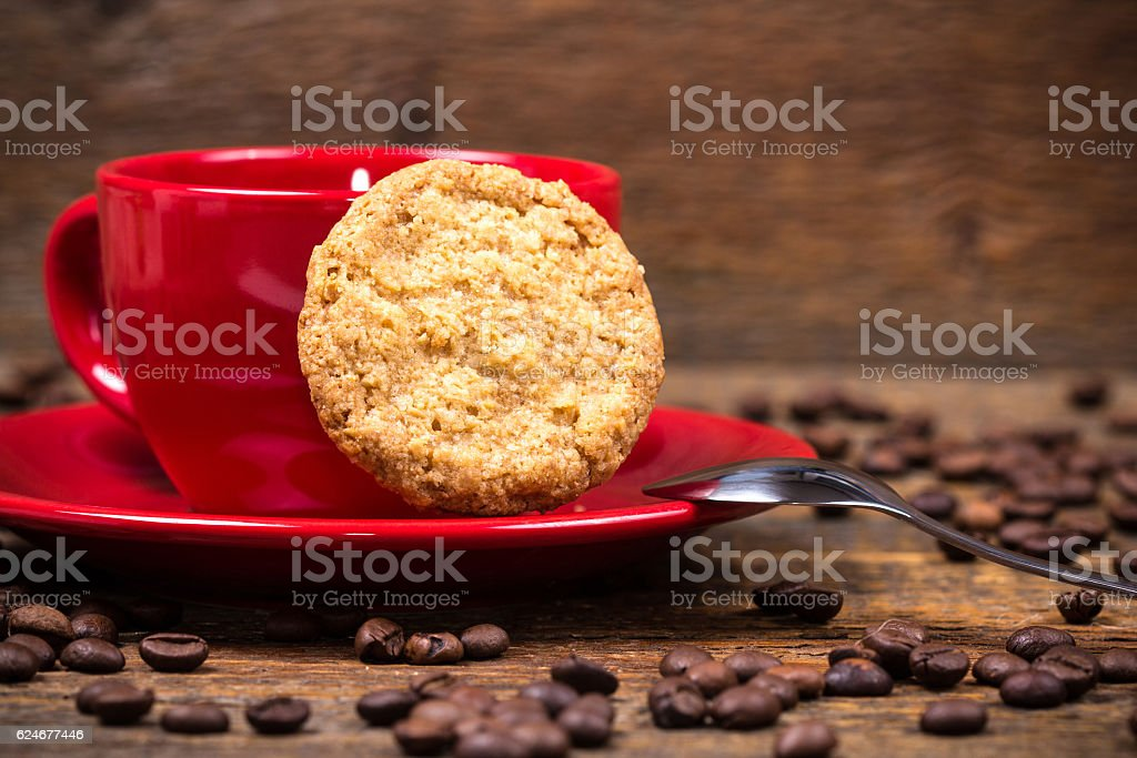Coffee cup with biscuit and coffeebeans stock photo