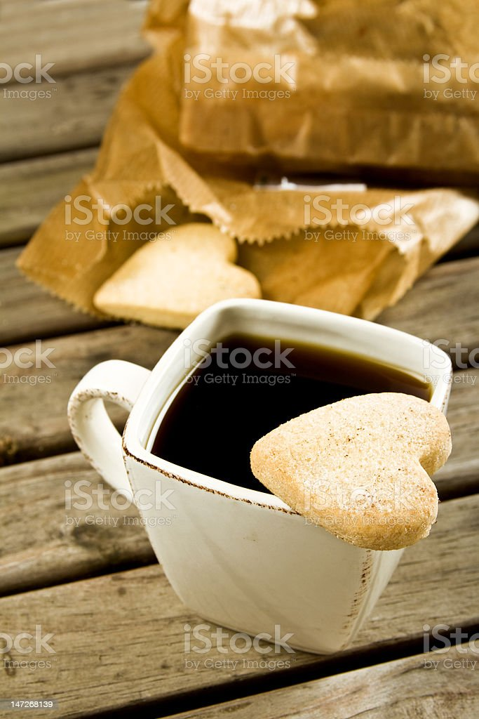 Coffee cup with biscuits and bag royalty-free stock photo