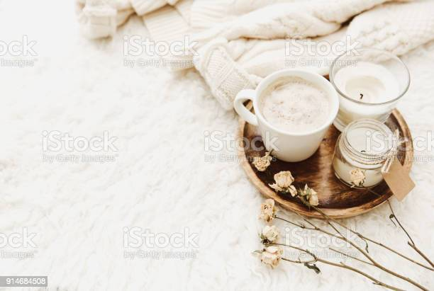 Coffee cup with candles in cozy home atmosphere warm sweater and dry picture id914684508?b=1&k=6&m=914684508&s=612x612&h=k4qh180rbi3fswyd00nebhdqdm vsyanryiqatojmku=