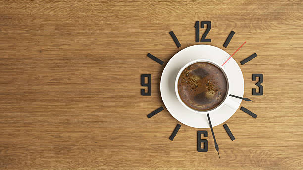 coffee cup with clock concept design background stock photo