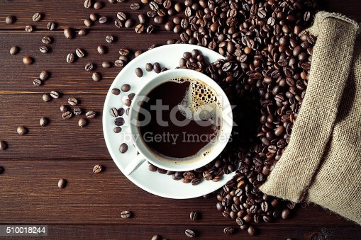 istock coffee cup with coffee beans 510018244