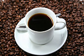 istock coffee cup with coffee-beans 172784156