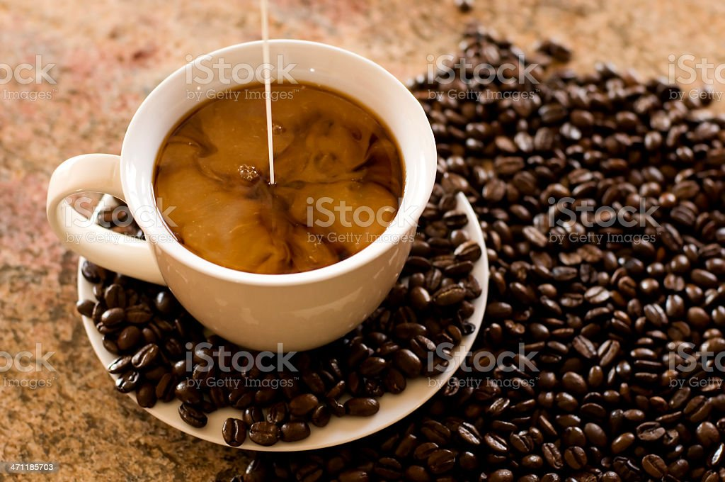 Coffee cup with cream royalty-free stock photo