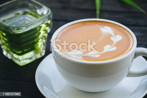 914465180istockphoto coffee cup with flower sign, 1163707562