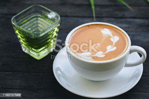 914465180istockphoto coffee cup with flower sign, 1163707569