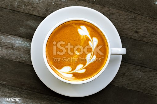 914465180istockphoto coffee cup with flower sign, 1163707571