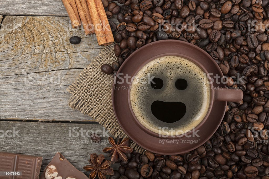 Coffee cup, spices and chocolate on wooden table texture with copy...