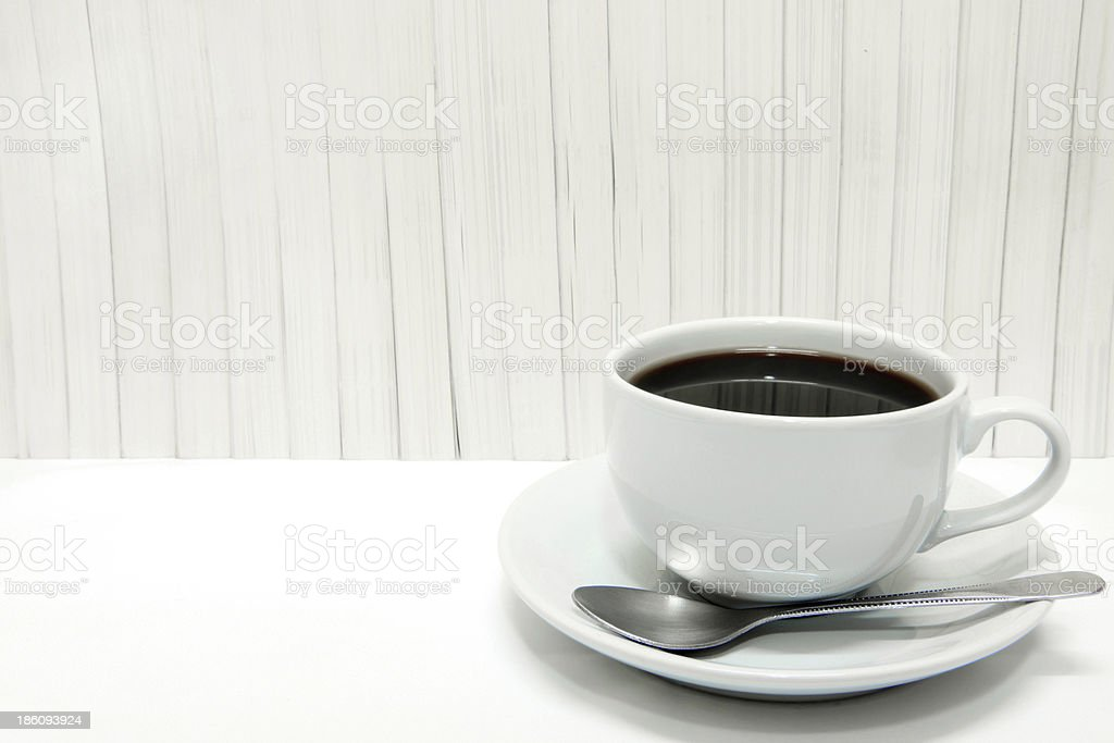 Coffee cup with stack of books. royalty-free stock photo