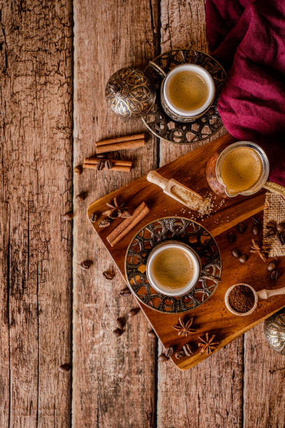 Coffee cups and coffee beans on a natural wood background stock photo