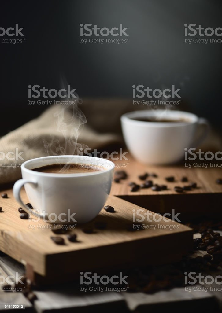 coffee cups and coffee beans stock photo