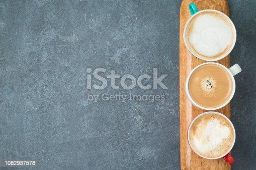 istock Coffee cups over blackboard background 1082937578