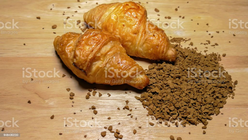 Bread and Croissant on the sackcloth with empty coffee cup and coffee...