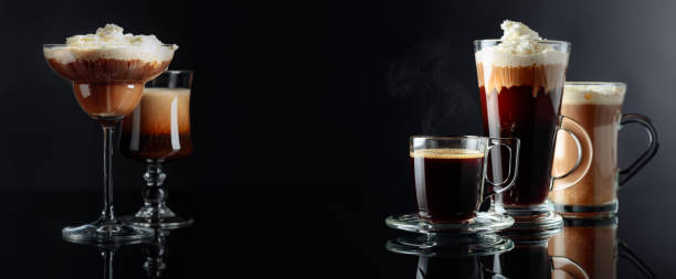 Coffee drinks, cocktails and dessert on black reflective background. stock photo