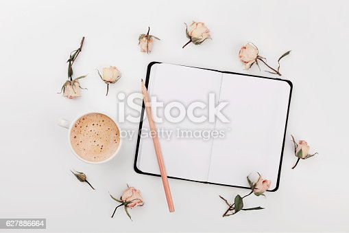 istock Coffee, empty notebook, dry roses flowers. Cozy Breakfast. Flat lay. 627886664
