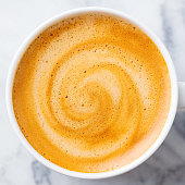 istock Coffee, espresso in white cup of marble table background. Close up. Top view. 1128030481