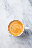 istock Coffee, espresso in white cup of marble table background. Top view. Copy space. 1126941015