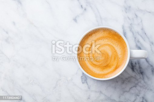 Coffee, espresso in white cup of marble table background. Top view. Copy space