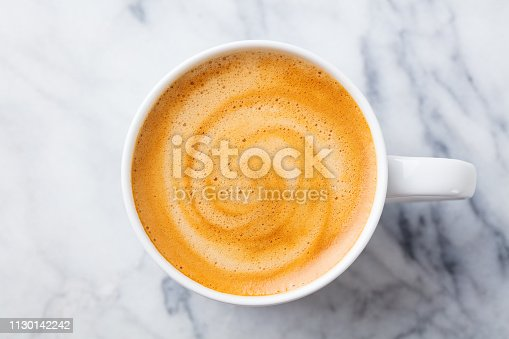 Coffee, espresso in white cup of marble table background. Top view