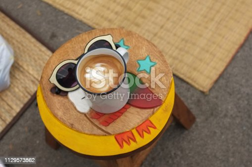 istock Coffee espresso on wood chair 1129573862