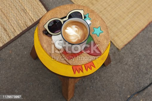 istock Coffee espresso on wood chair 1129573997