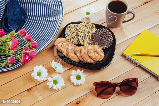 885959540 istock photo Coffee espresso stands on a wooden table with cookies, pad and pencil. 843029804
