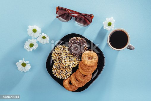 885959540 istock photo Coffee espresso stands on a wooden table with cookies, pad and pencil. 843029944