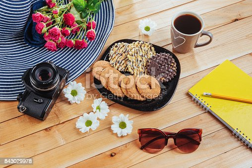 885959540 istock photo Coffee espresso stands on a wooden table with cookies, pad and pencil. 843029978