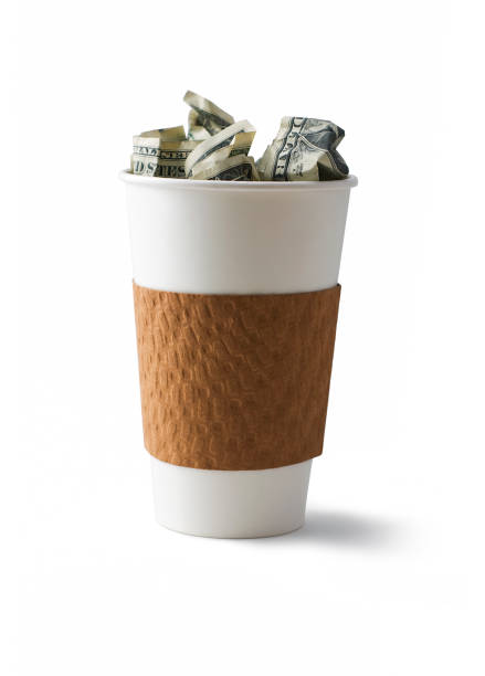 Coffee filled with cash stock photo